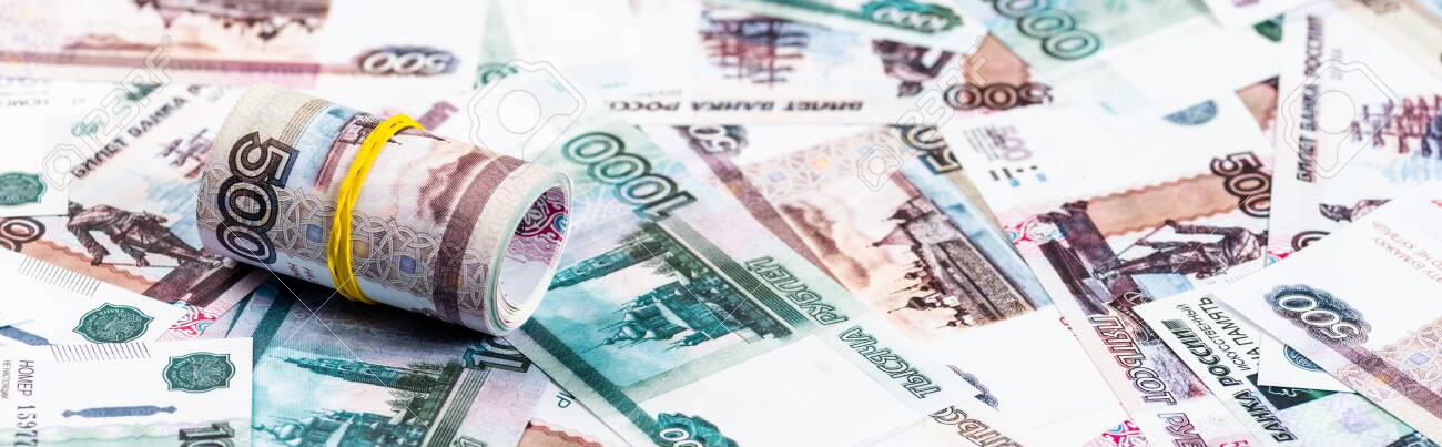 panoramic shot of cash roll on russian money - 131397208