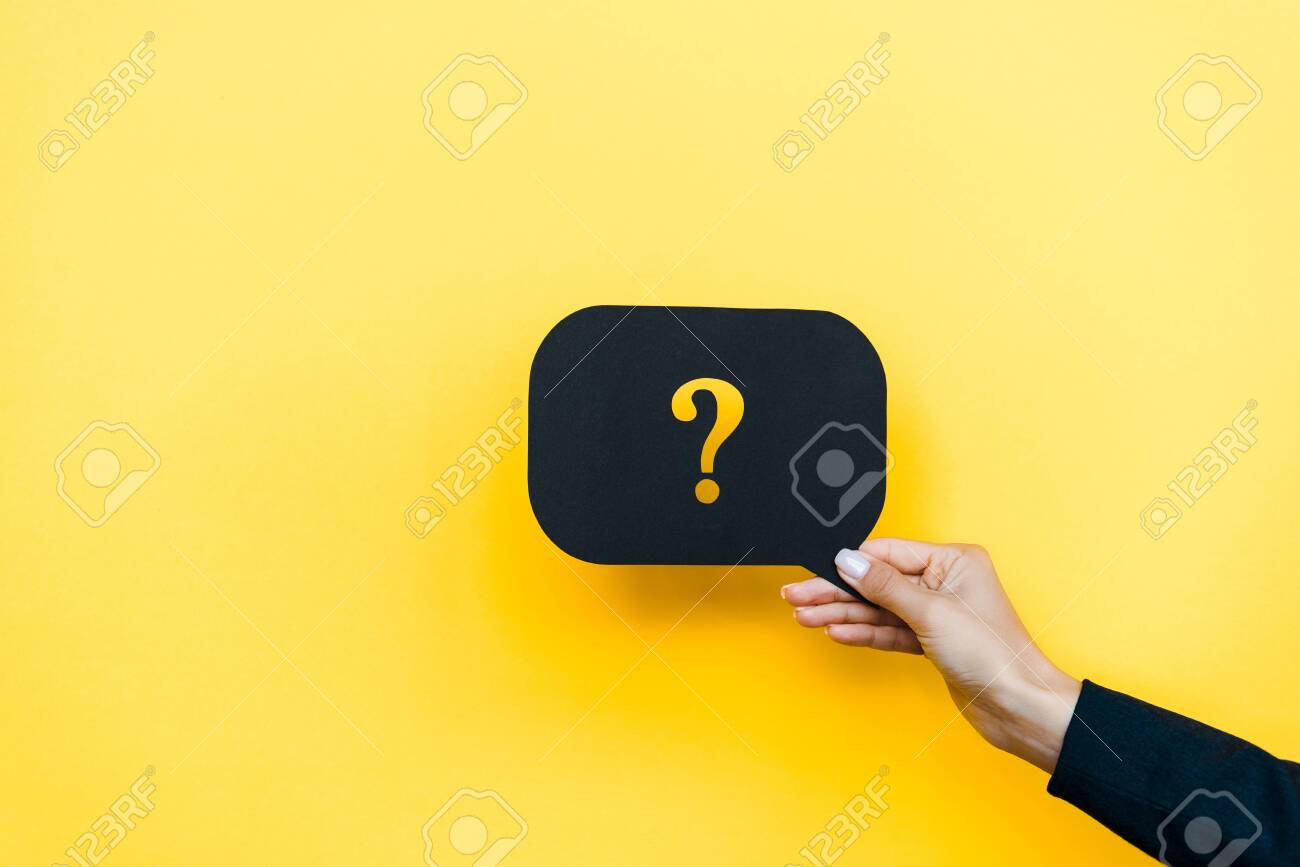 cropped view of woman holding black speech bubble with question mark on orange - 131819466