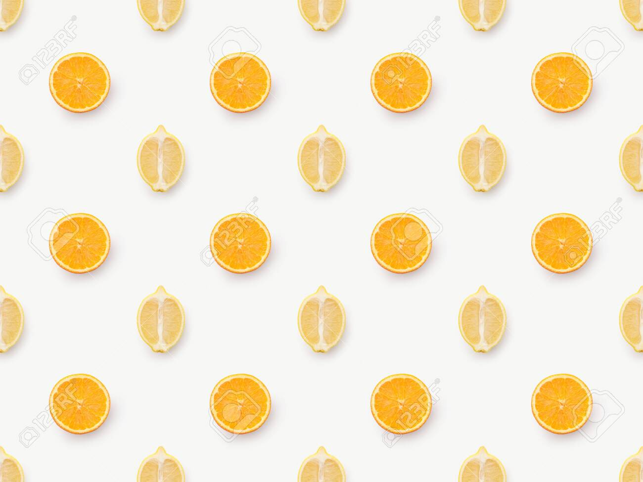 Top view of orange slices and lemons halves on white background - 141262168