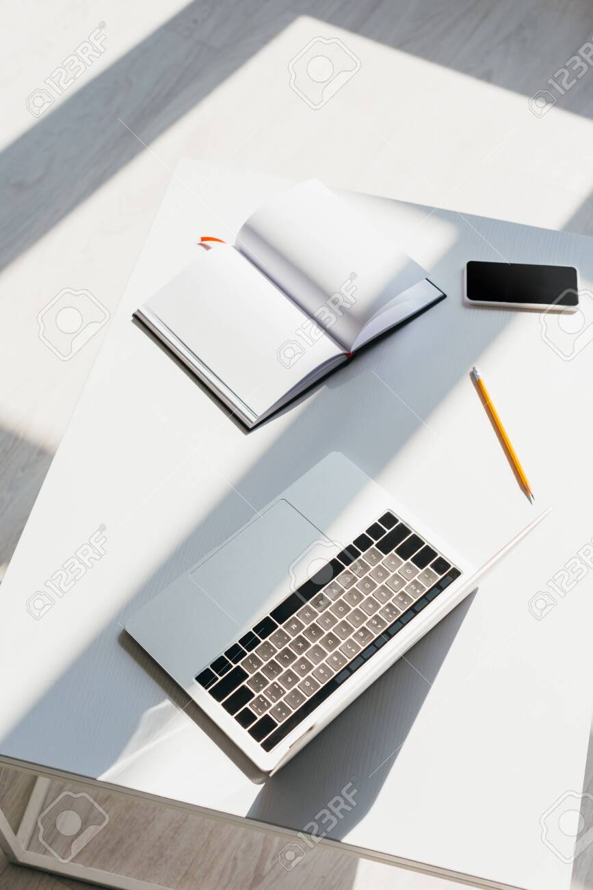 empty workplace with laptop, smartphone, notepad and pencil - 146235225