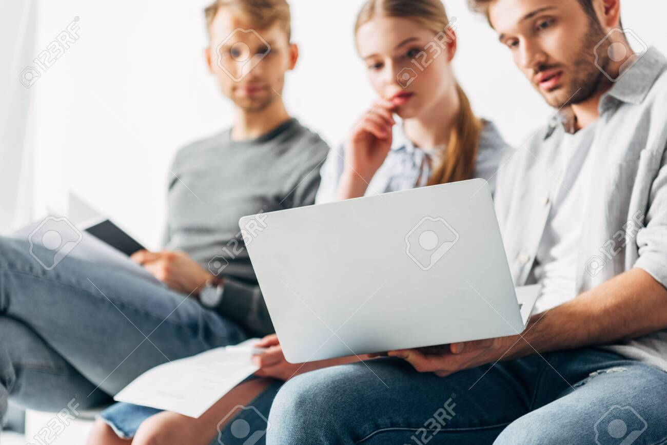 Selective focus of employees looking at laptop while waiting for job interview - 146711276