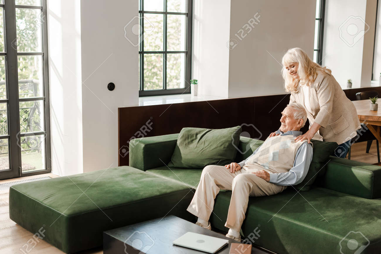 happy senior husband and wife doing massage and chilling at home on quarantine - 149456890