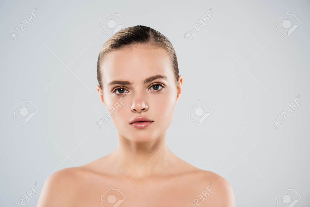 young woman looking at camera isolated on gray - 152120048