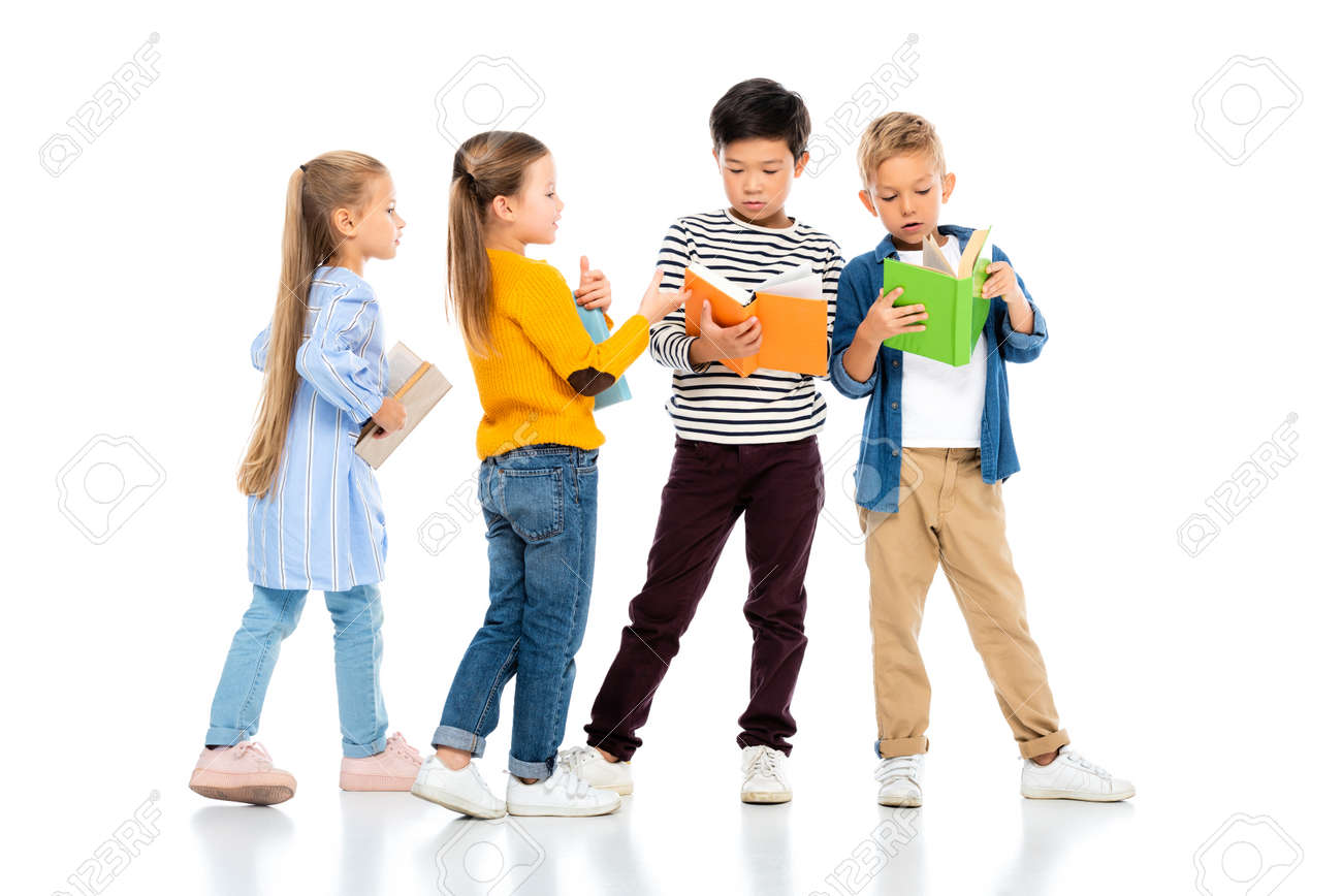 Multiethnic kids holding colorful books on white background - 159543613