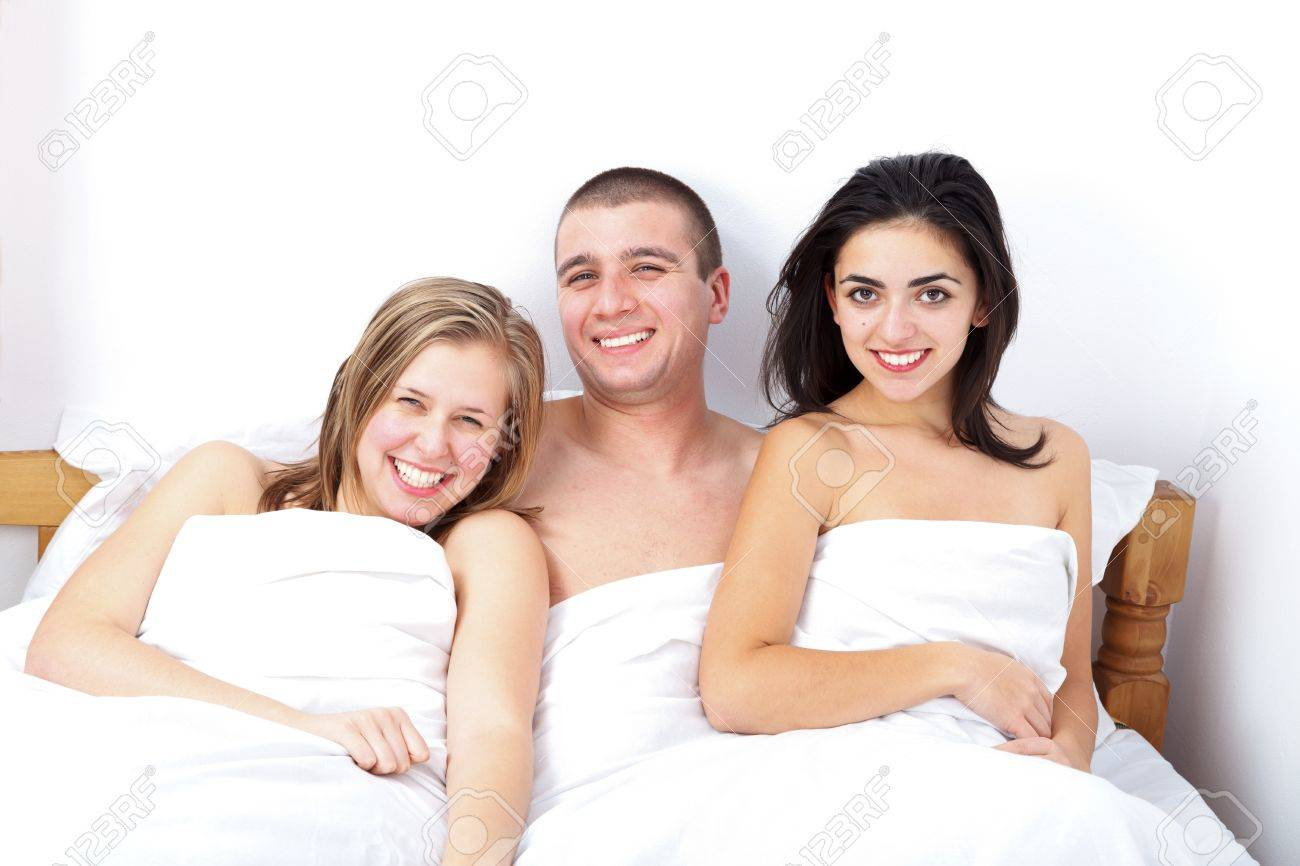 Threesome in bed