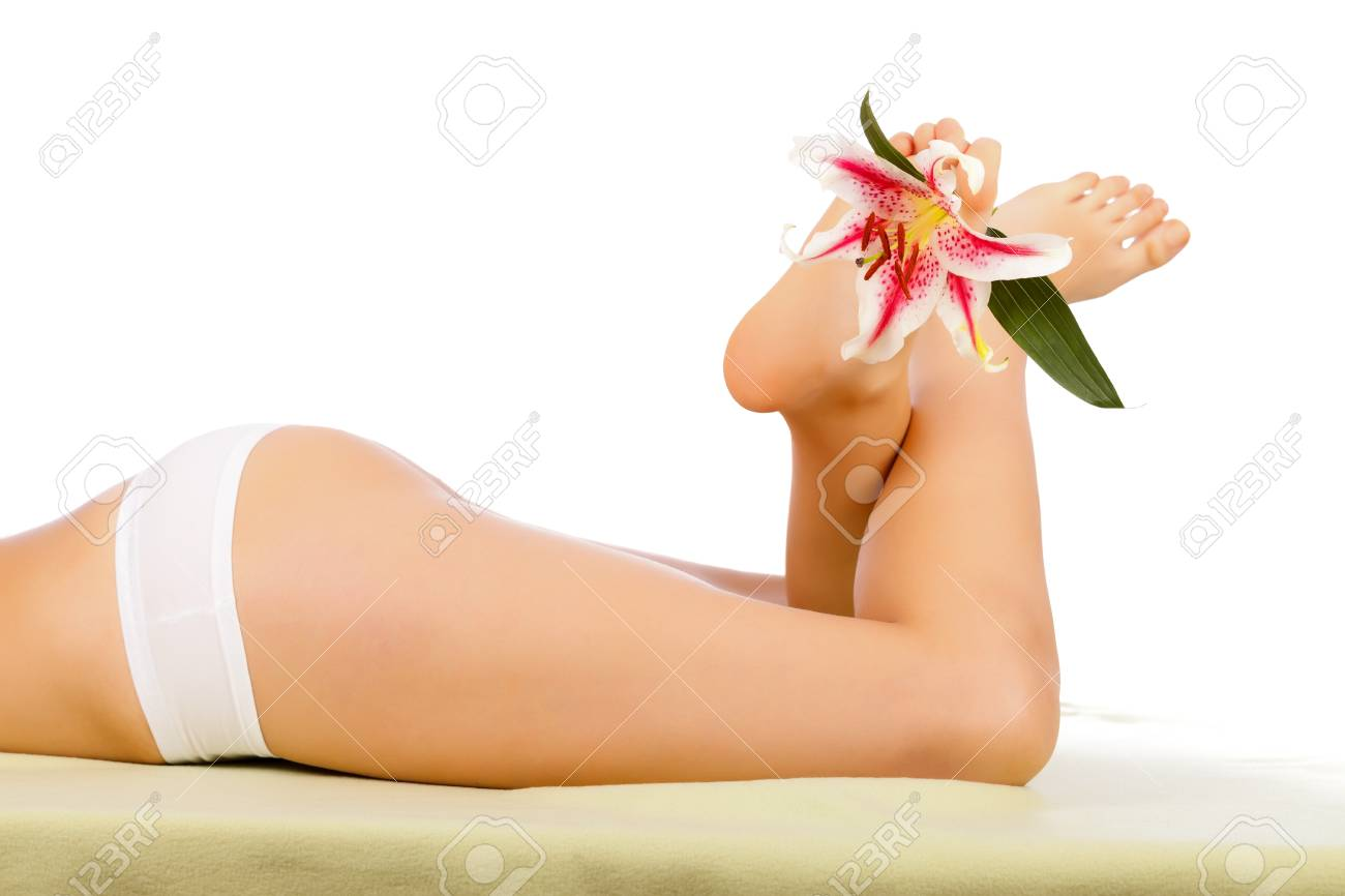 Beautiful Woman Body Lying With Legs Lifted Isolated. Stock Photo - 20794662