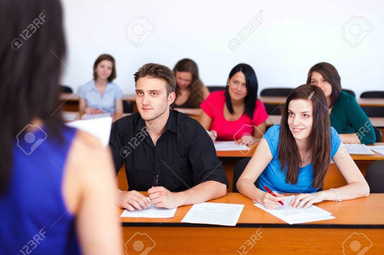 Kind students looking attentively at their teacher. Stock Photo - 20796761