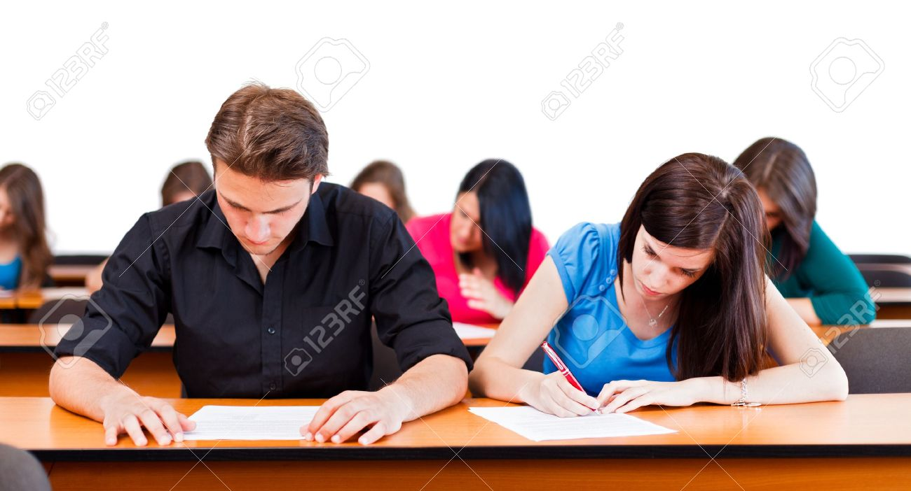 Students at university writing test in classroom. Stock Photo - 21829688