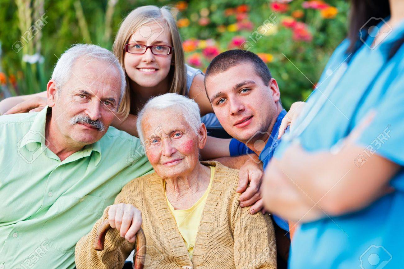 Elderly woman with her family supervised by a doctor. Stock Photo - 21830192