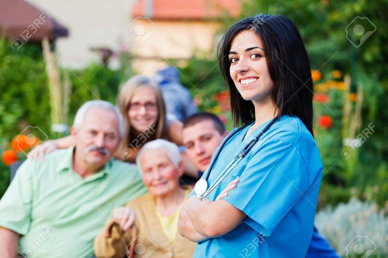 Confident doctor welcoming multigenerational family in residential care home. Stock Photo - 21829678