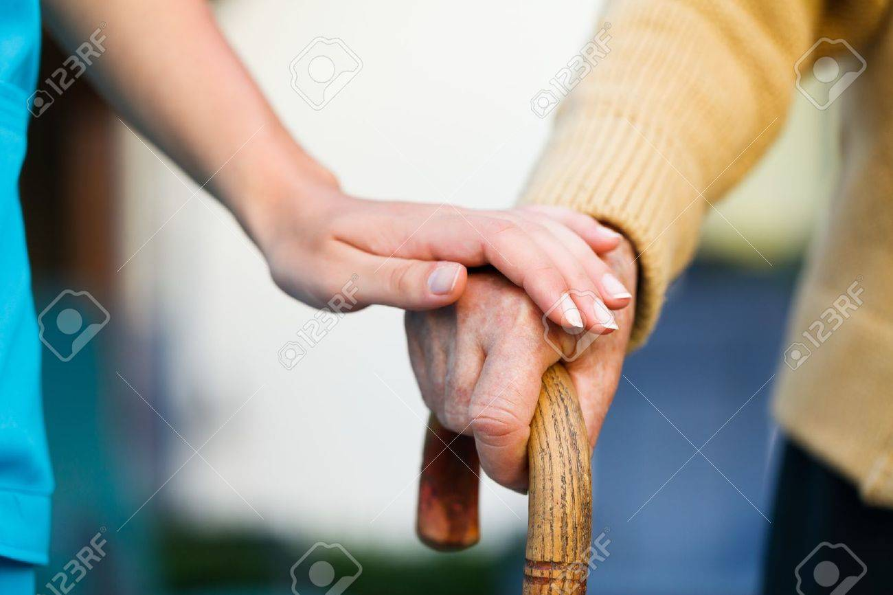 Doctor holding a senior patiens 's hand on a walking stick - special medical care concept for Alzheimer 's syndrome. Stock Photo - 21829681