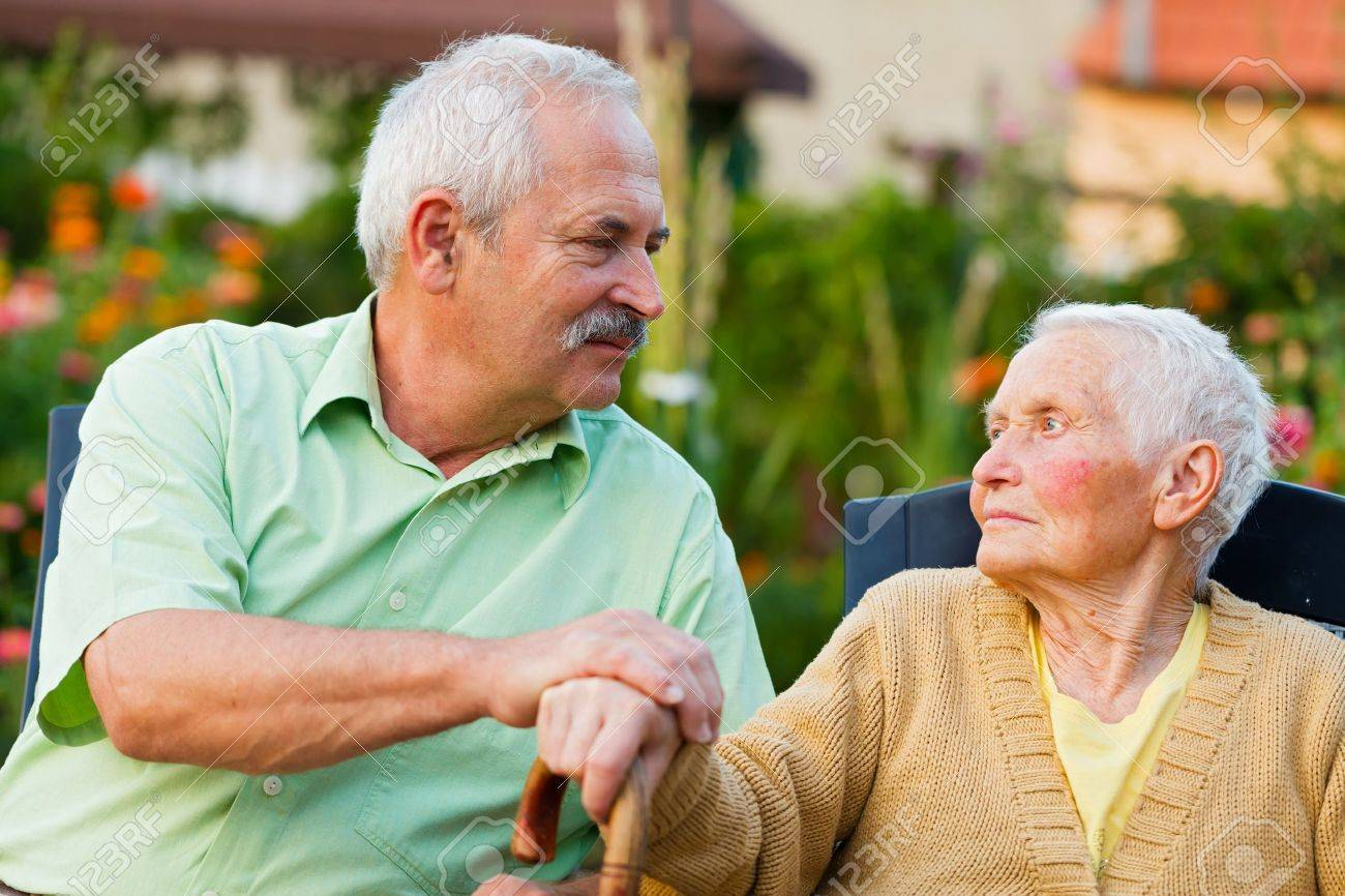 Caring son saying goodbye to her mother when leaving the residential home. Stock Photo - 21829794