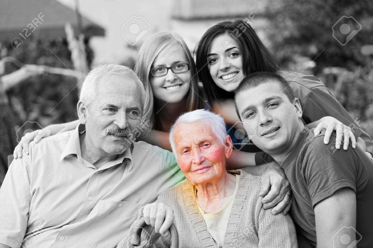 Alzheimer 's concept - when the world closes in. An elderly woman surrounded by her family. Stock Photo - 22247433