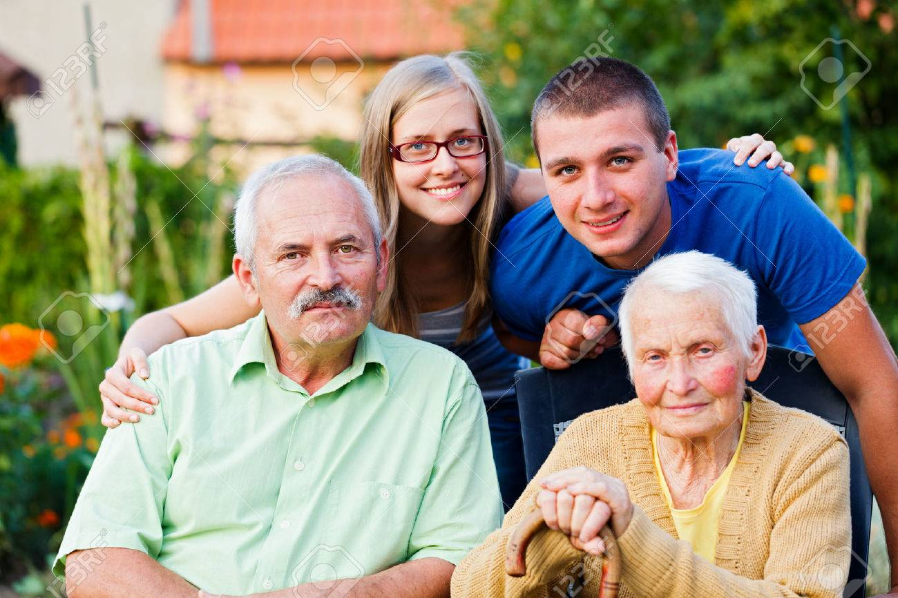 Happy multigenerational family visiting the elder member - the grandmother - in a nursing home. Stock Photo - 22247468