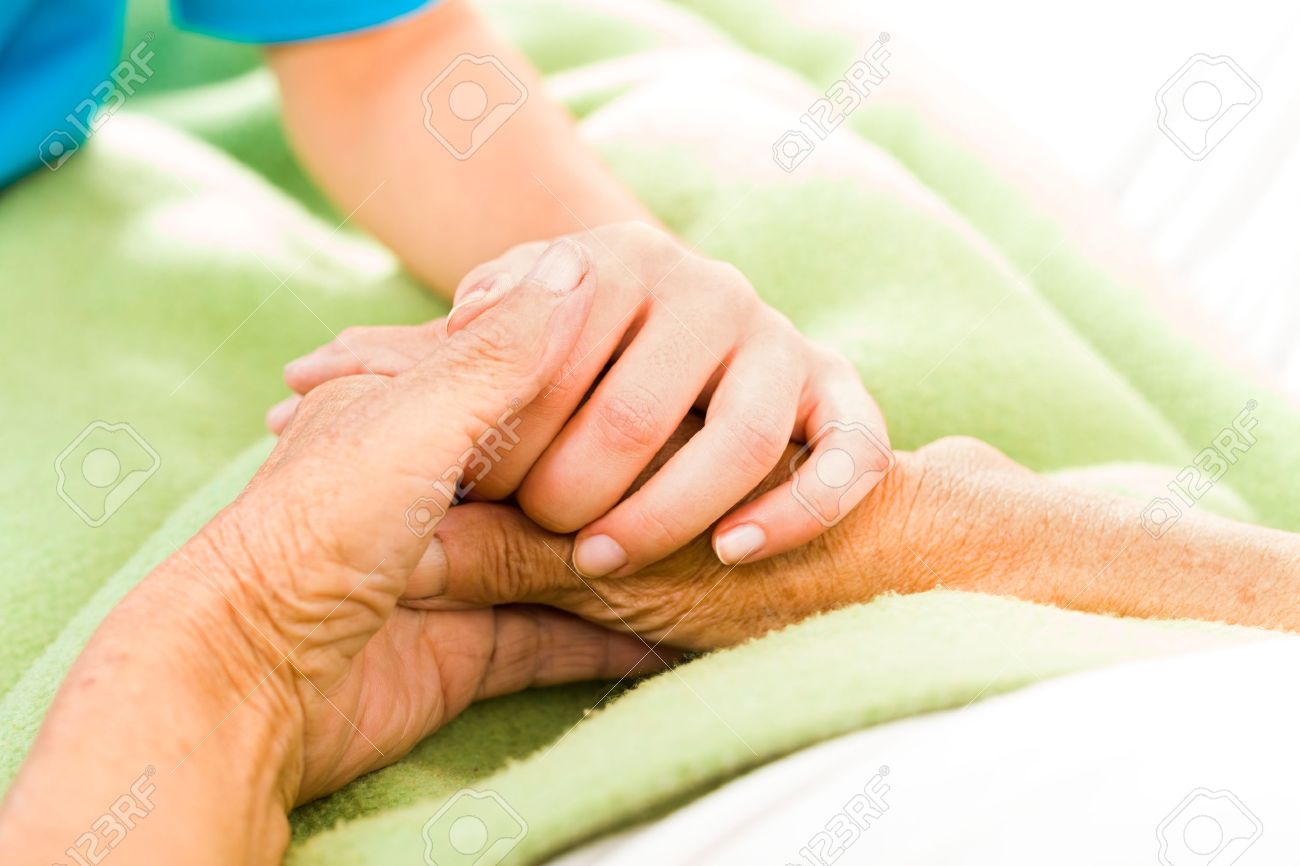 Health care nurse caring for elderly concept - holding hands. Stock Photo - 26421062