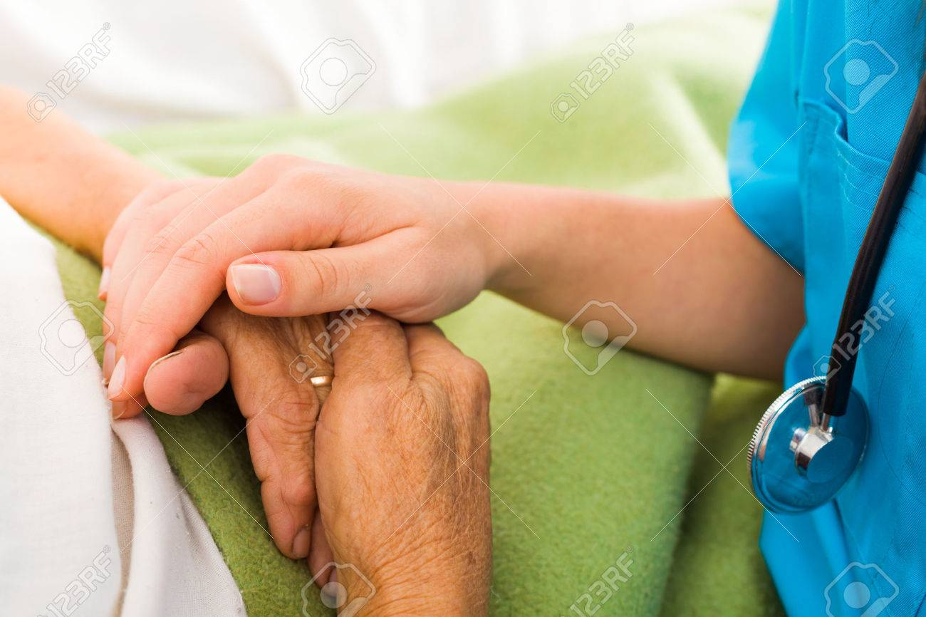 Social care provider holding senior hands in caring attitude - helping elderly people. Stock Photo - 26421071