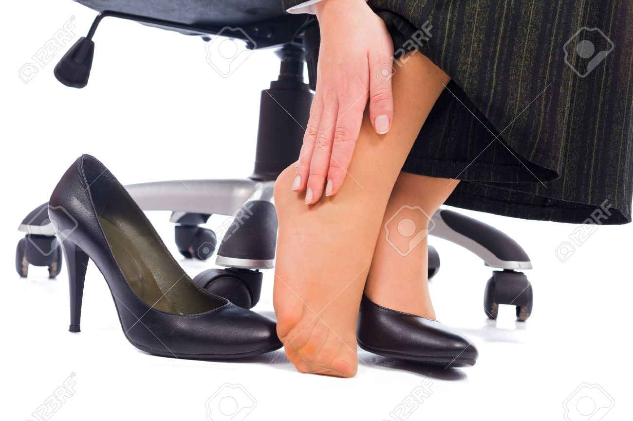 Wearing high heels has its painful disadvantages - hurting feet, ankle. Stock Photo - 26421119