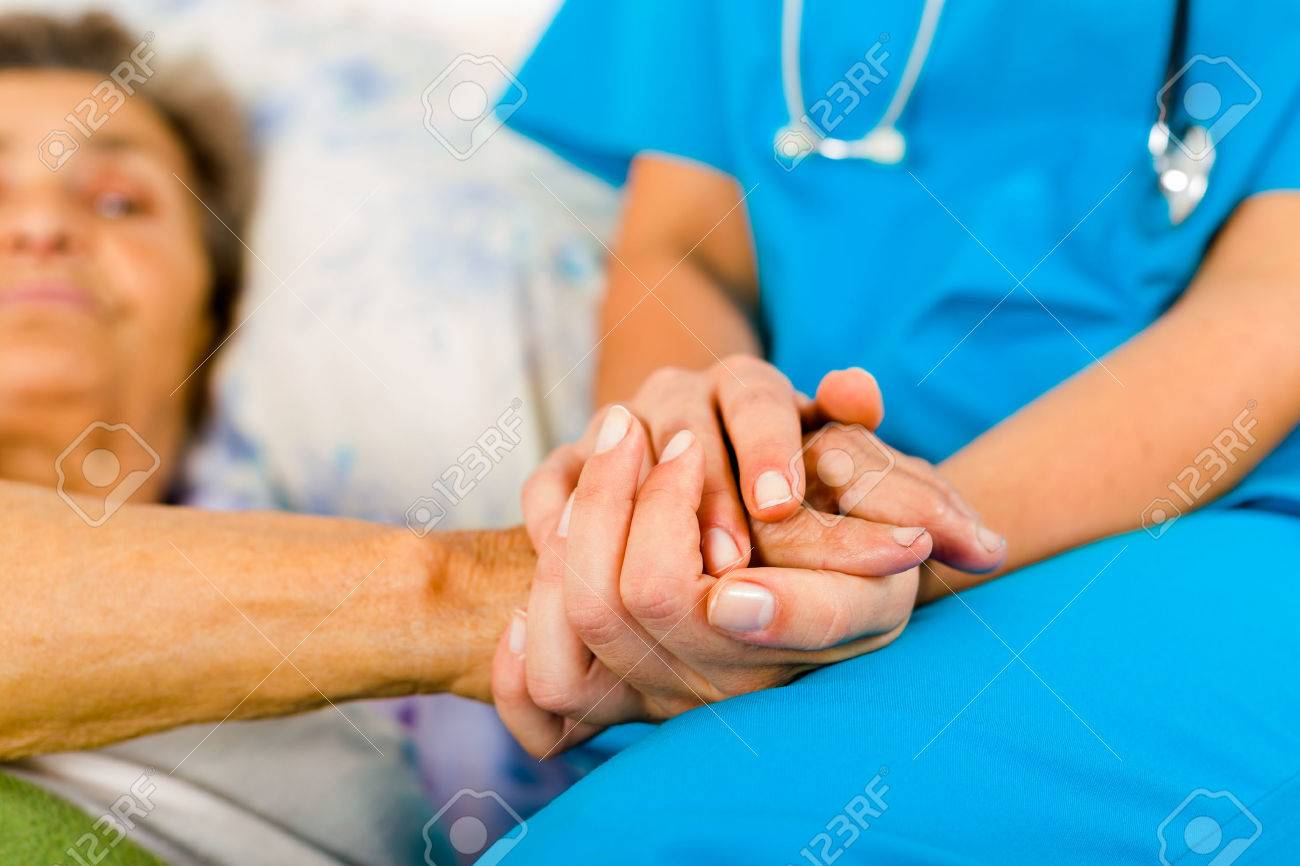 Social care provider holding senior hands in caring attitude - helping elderly people. Stock Photo - 42099795