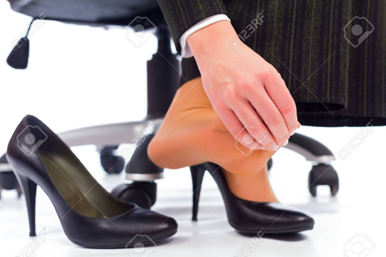 Plantar Fasciitis - hurting toes after wearing every day high heels. Stock Photo - 41761556
