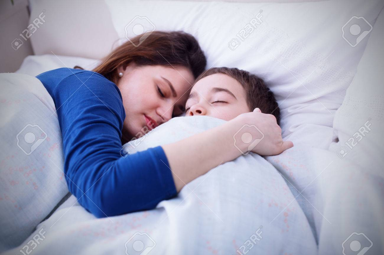 Mother and son sleep together