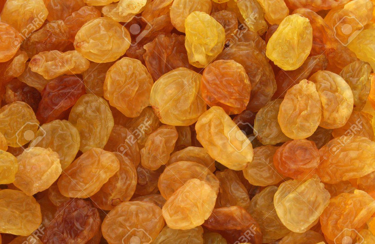 Background of golden, yellow and brown shiny raisins made from white grapes Stock Photo - 759091