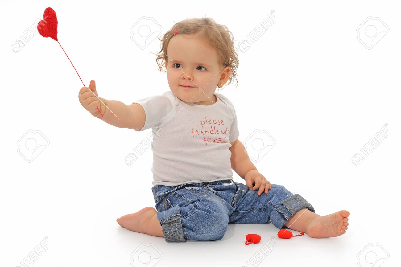 Lovely one year old girl playing with red hearts Stock Photo - 801175