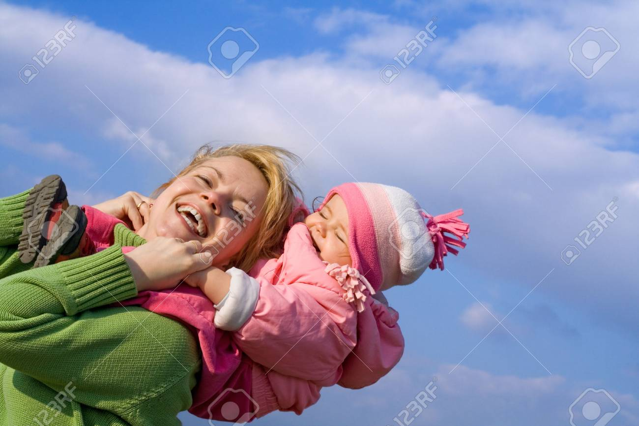 Mother and baby girl having fun outdoors in sunny springtime Stock Photo - 915243