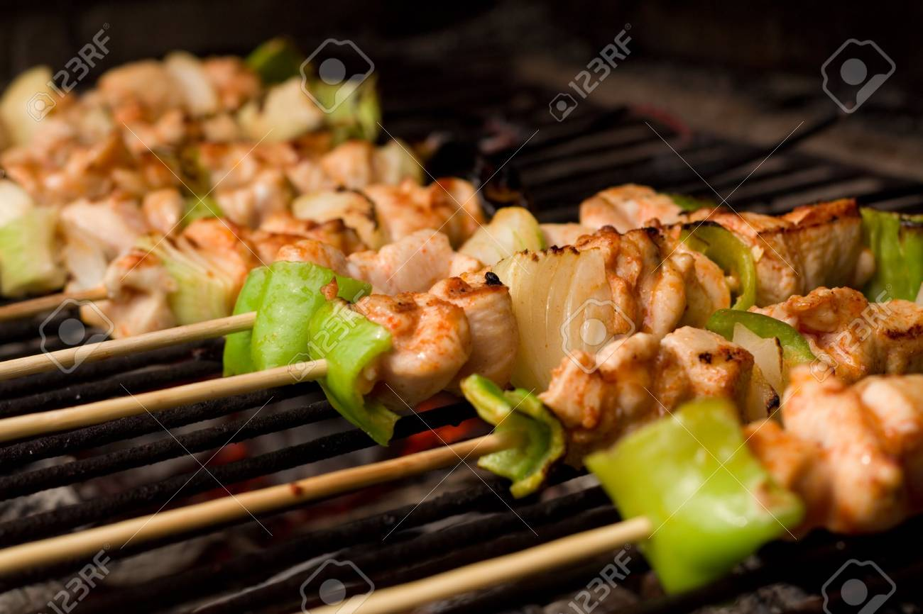 Barbecue on sticks - meat and vegetables frying Stock Photo - 2064313