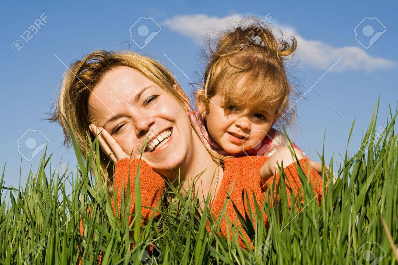 Woman and little girl having fun in the grass Stock Photo - 2948950