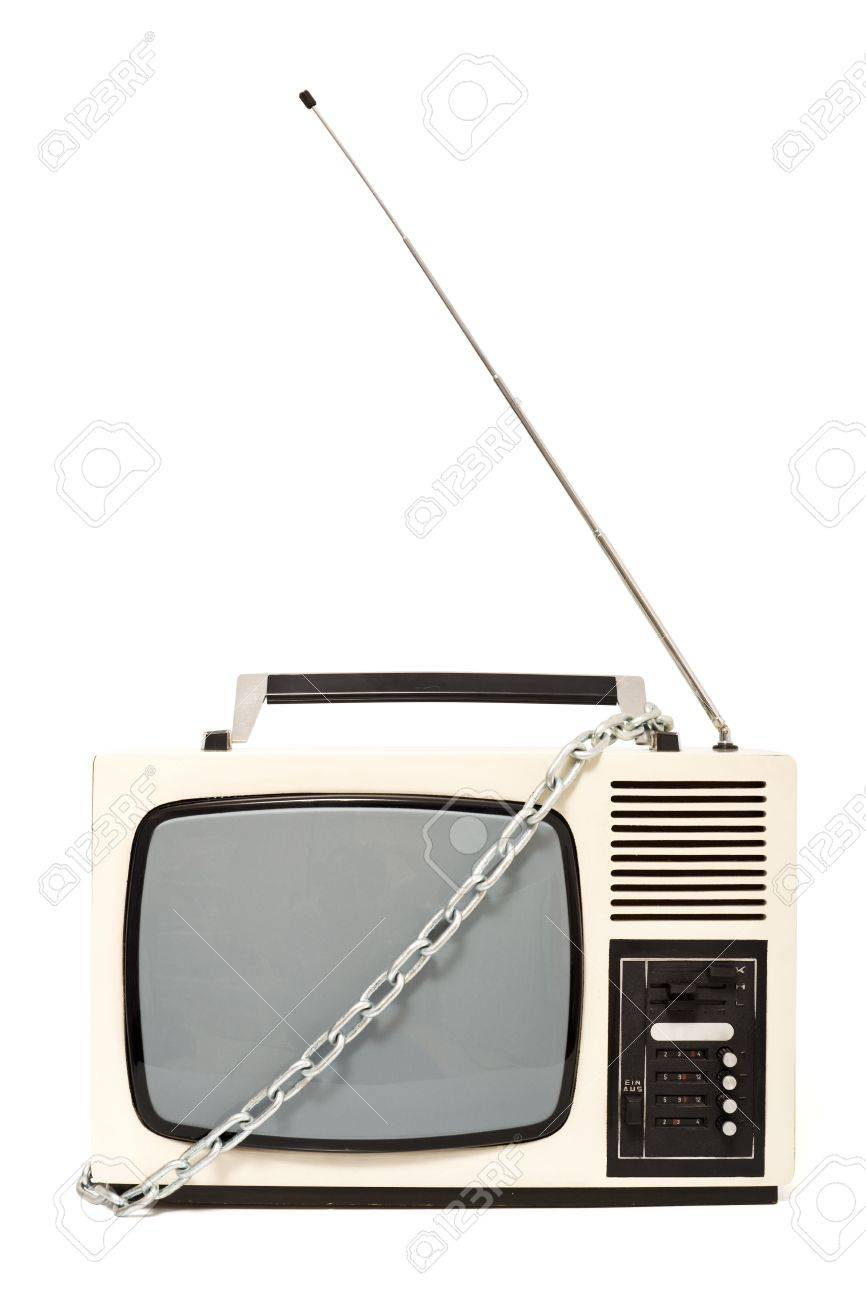 Old fashioned television set in chains - censorship concept Stock Photo - 5852123
