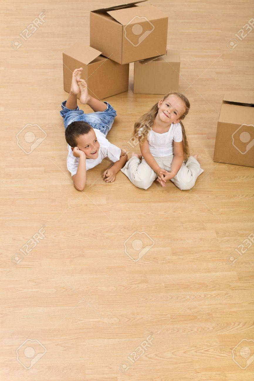 Kids on the floor in their new home - top view, copy space Stock Photo - 8054971