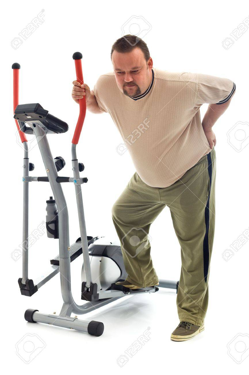 Man holding his aching back leaning on exercising device - isolated Stock Photo - 8386043