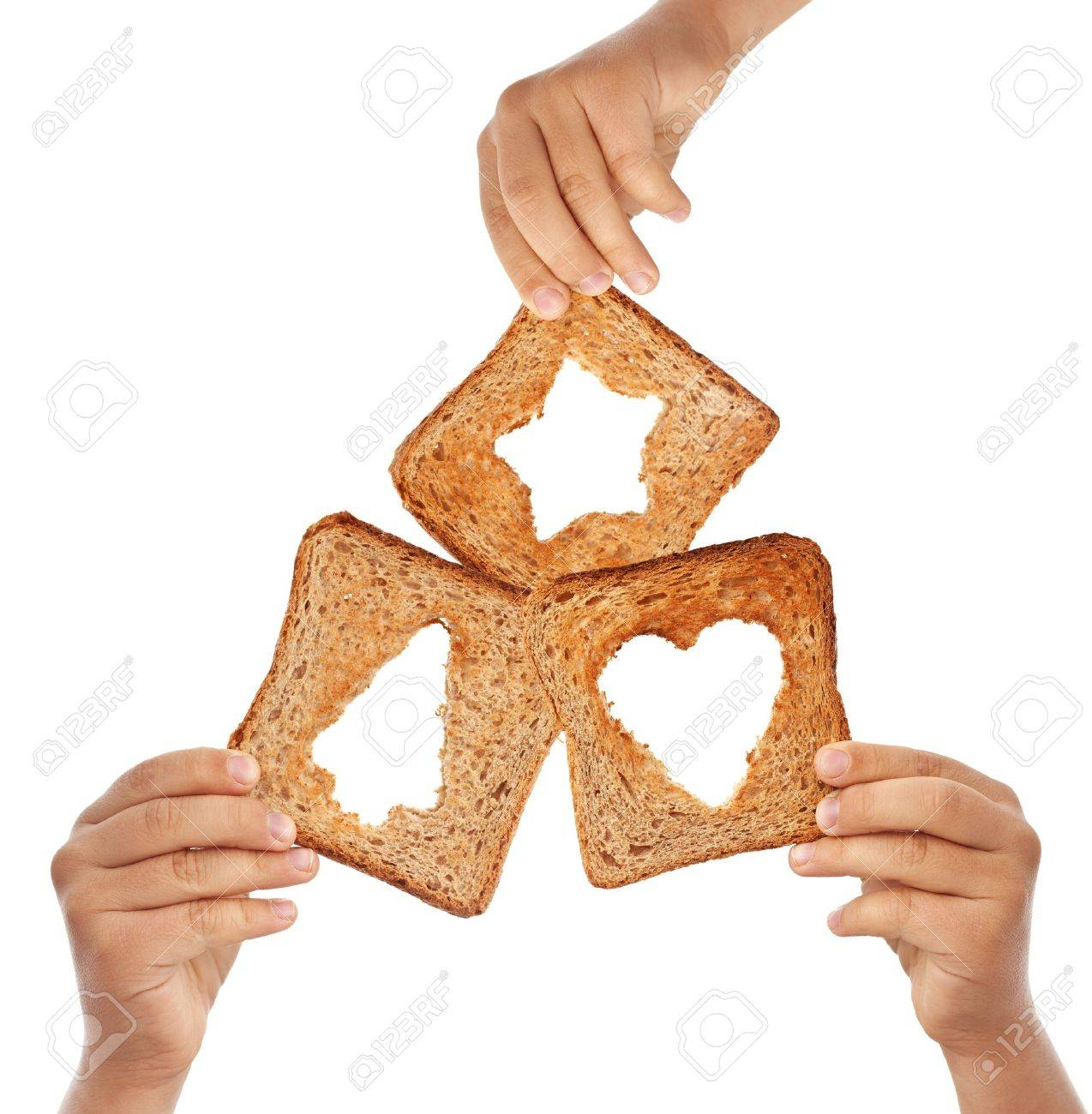 Kids hands holding bread with christmas symbols - love and sharing concept Stock Photo - 11105946