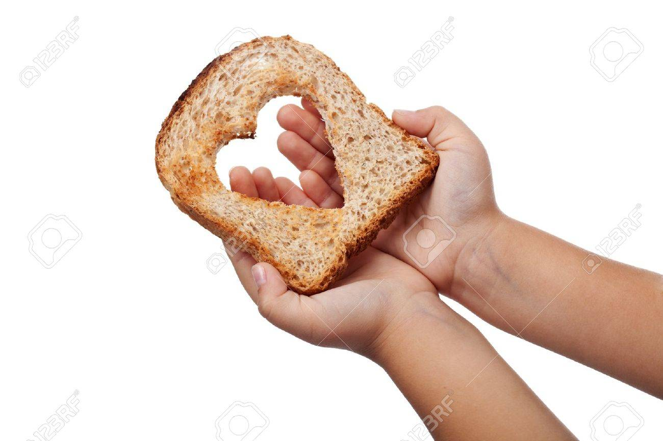 Giving food with love concept - slice of bread in child hands, isolated Stock Photo - 11157180