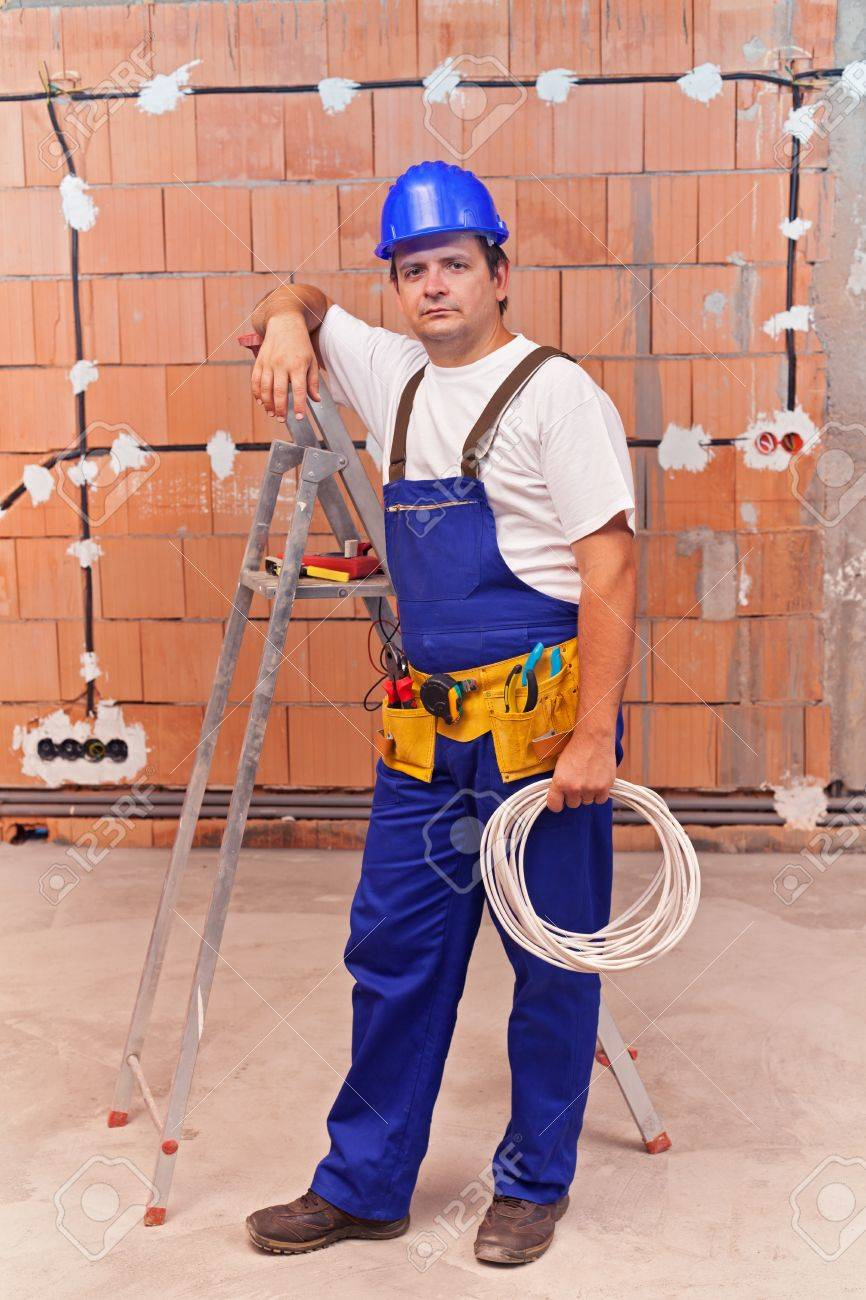 electrician at work site in a new building installing wires stock rh 123rf com