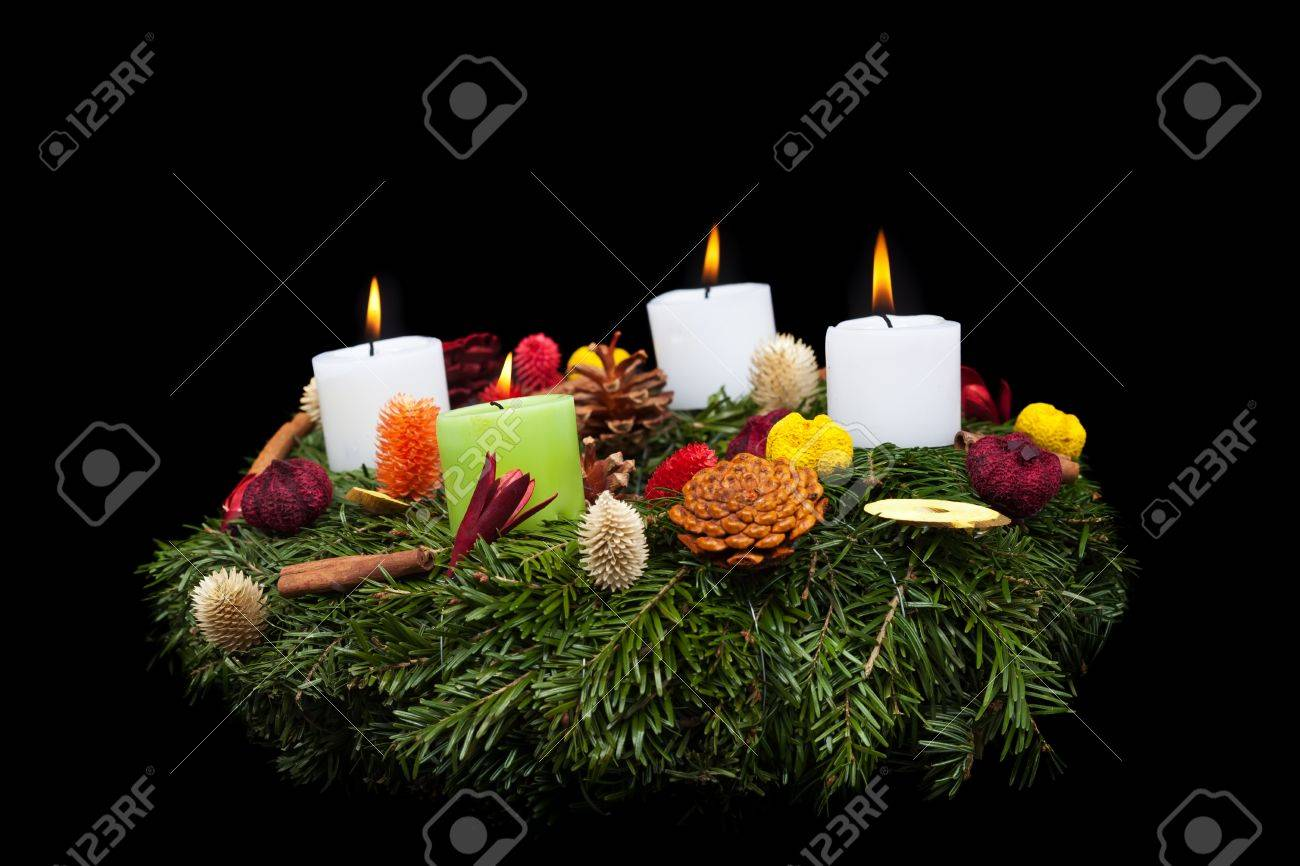 Traditional advent wreath with natural decorations -  isolated on black Stock Photo - 15900302