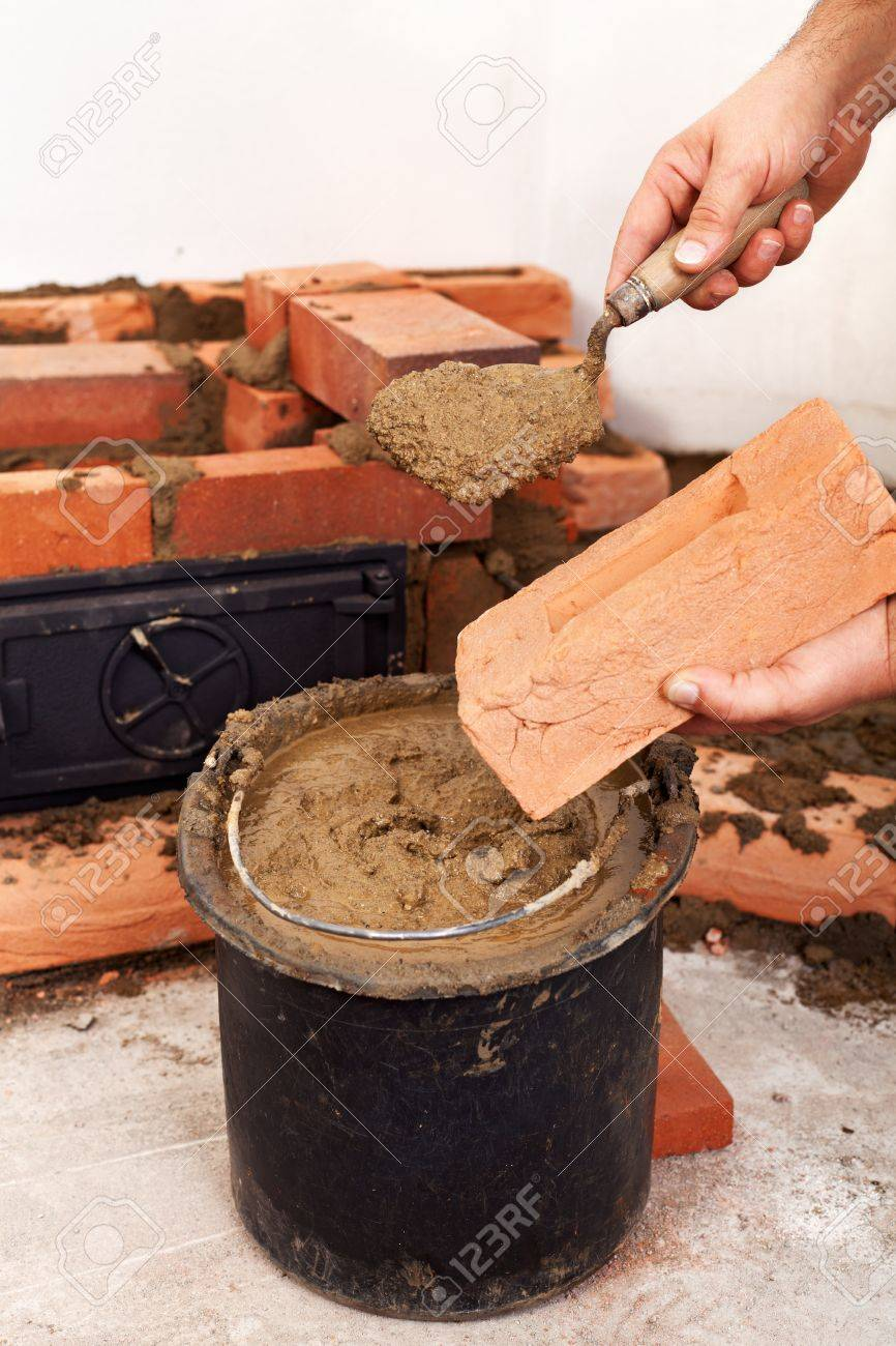 Building A Fireplace Clay Mortar Stock Photos Images Royalty Free Clay Mortar Images