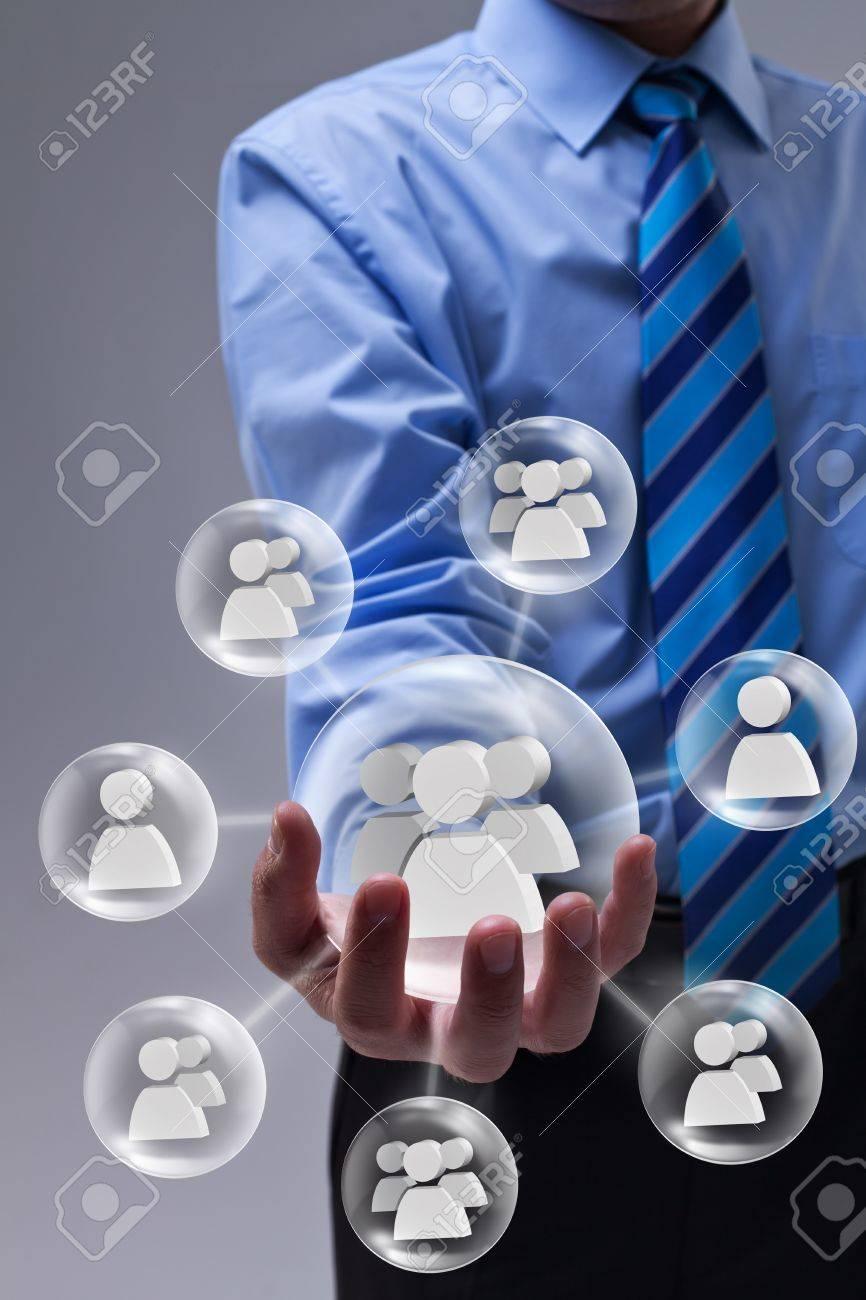 Businessman using social networking as a marketing tool - 17817885