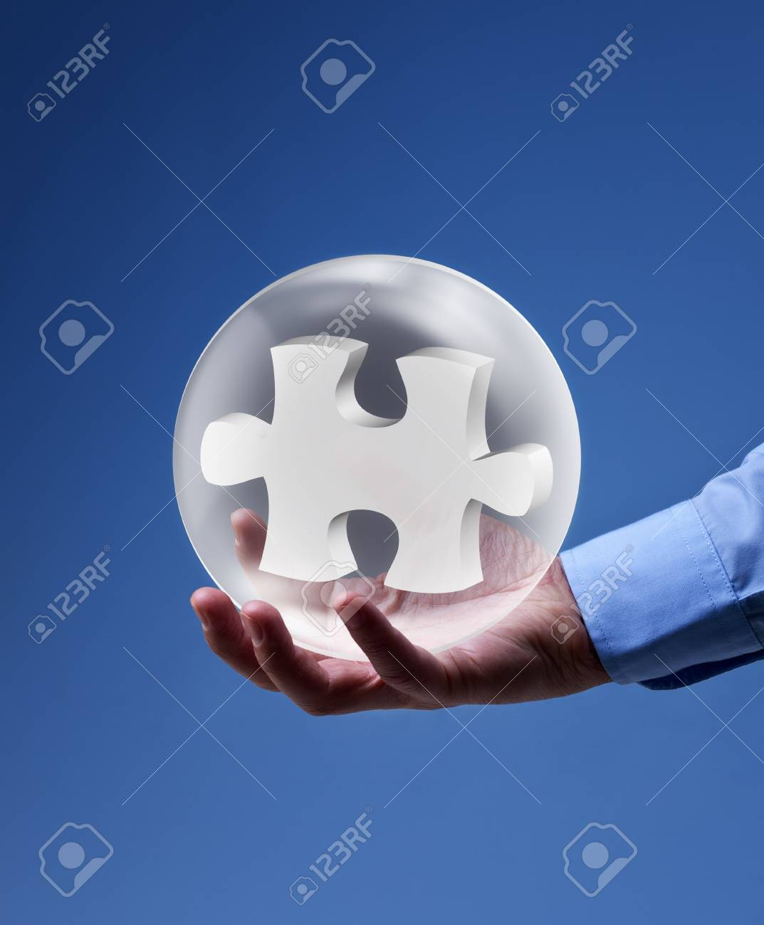 The key piece of a solution concept - puzzle pieces in glass bubbles Stock Photo - 18013894