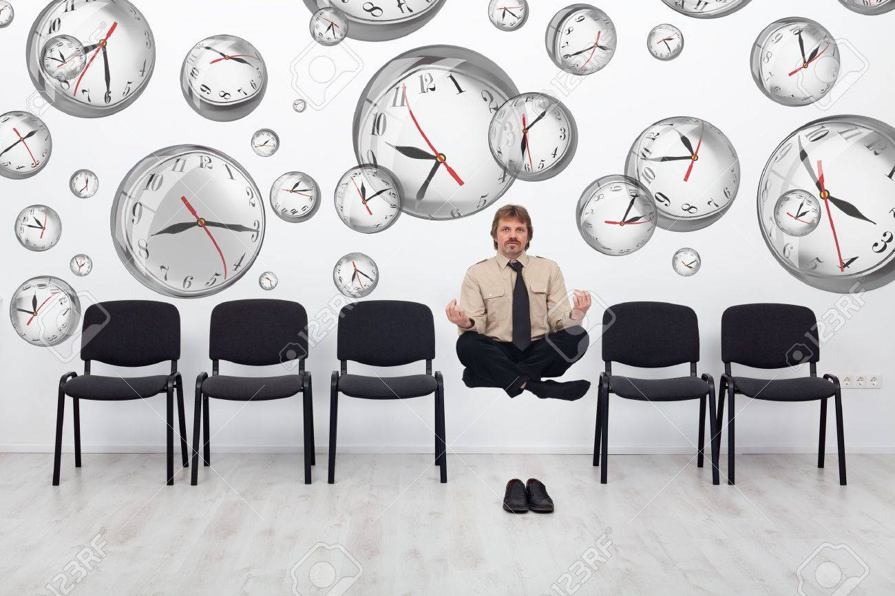 Project manager juggling with deadlines - surrounded by distorted wall clock bubbles - 18162647