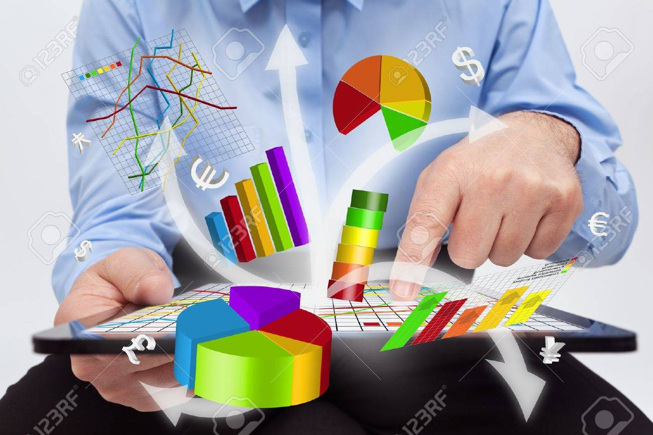 Businessman working on tablet computer - producing charts and reports Stock Photo - 18434974