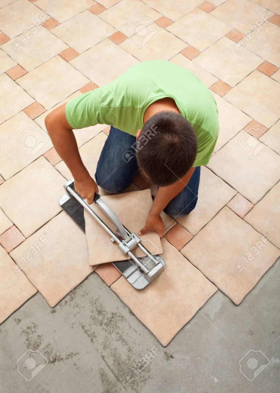 Worker Cutting Ceramic Floor Tile - Top View Of The Work Site Stock ...