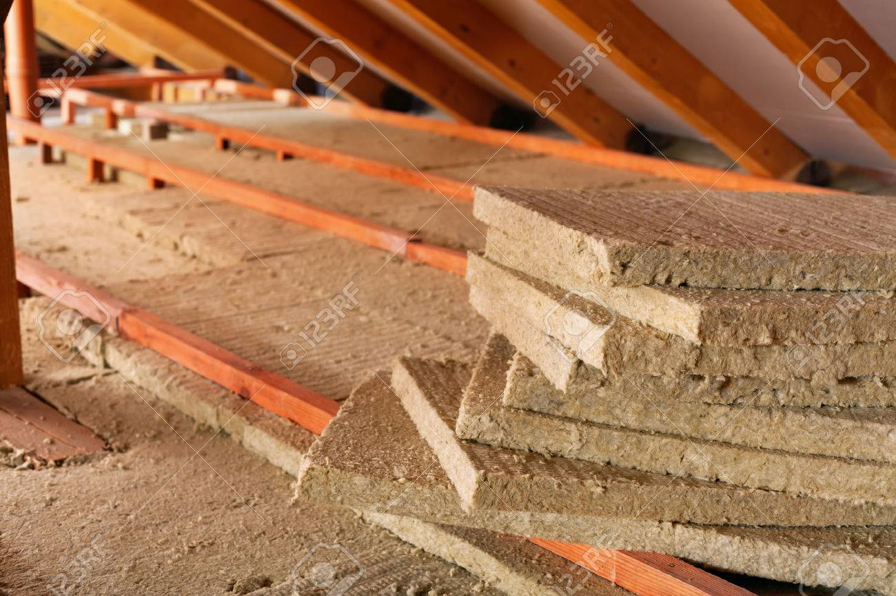 Mineral wool stack on construction site - thermal insulation of a house - 35647516