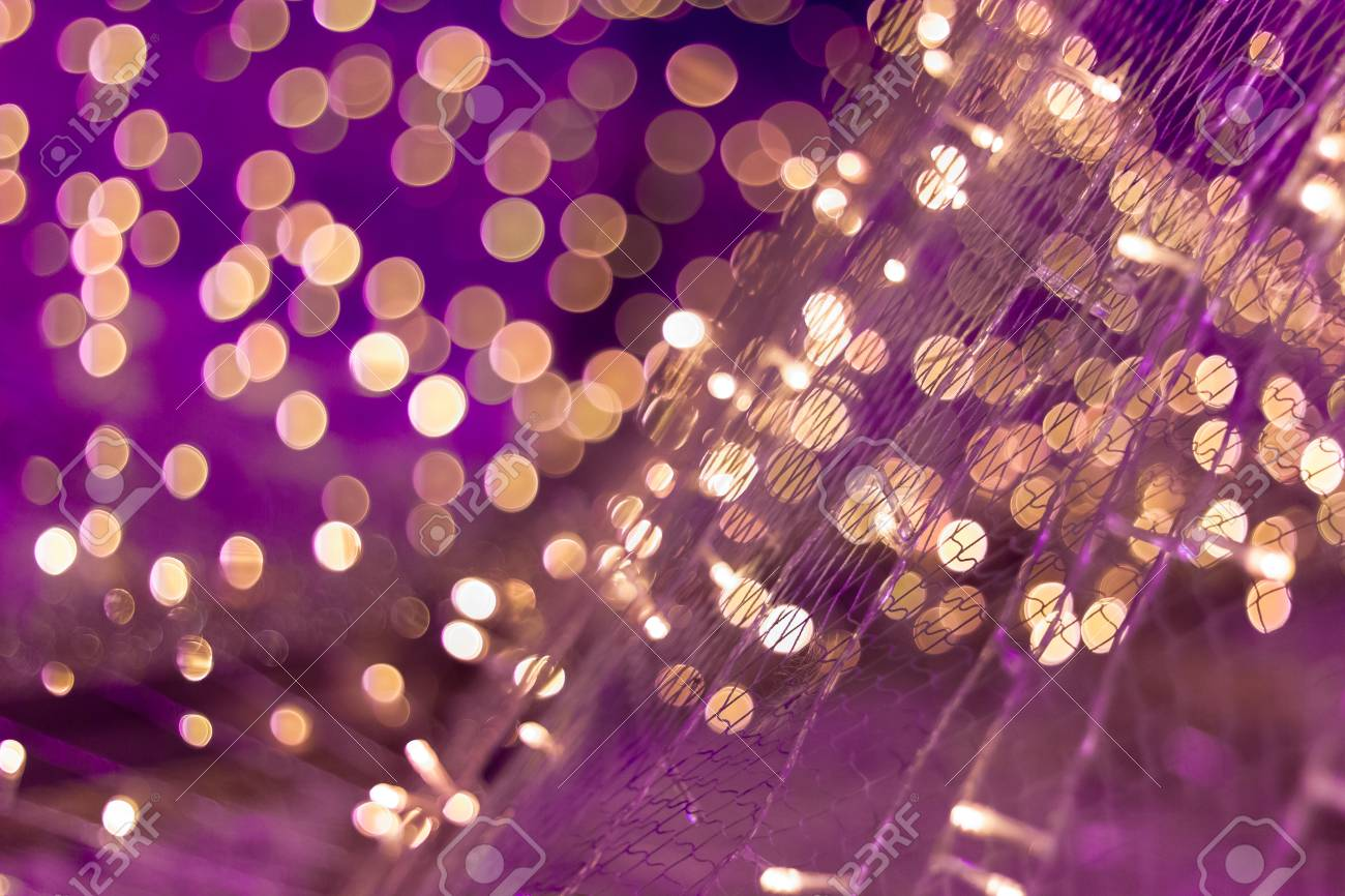 defocused christmas lights on purple colors tone stock photo 35119352