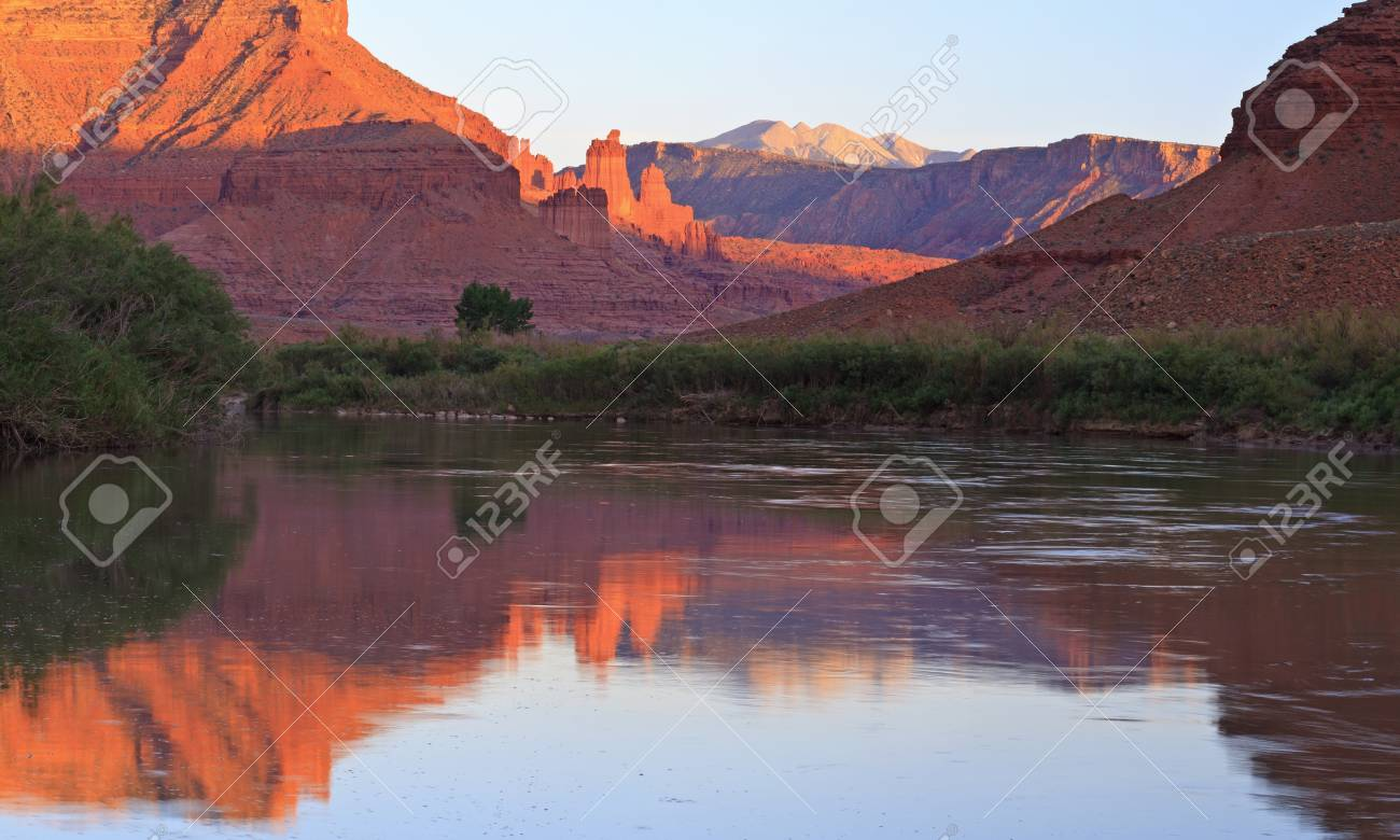Panoramic image of the Fisher Towers partially lit by the late afternoon sun reflected in the Colorado River near Moab,Utah Stock Photo - 15876012