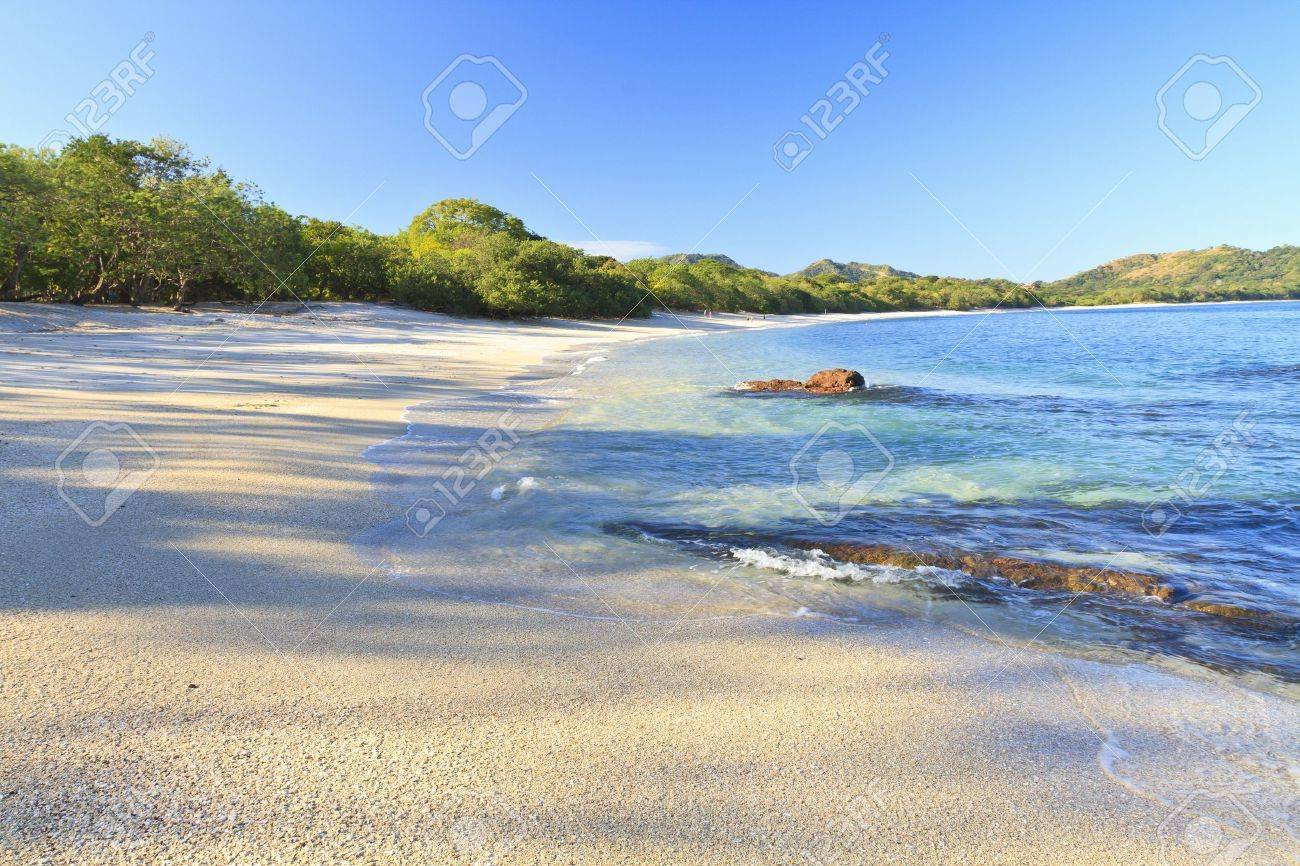 Sand and shells on Playa Conchal and the azure waters of the Pacific Ocean in Guanacaste, Costa RIca Stock Photo - 16712022
