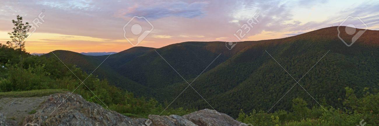 The last rays of sun hit the ridgeline on Mt. Greylock, seen from Stony Ridge in Northwest Massachusetts - 18510579