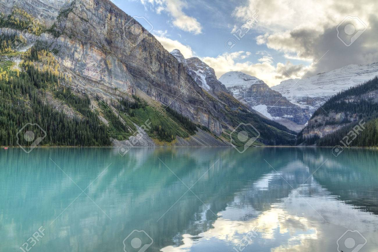 Mountains and glaciers reflected in the idyllic azure glacial waters of Lake Louise, Alberta, Canada HDR - 23708666