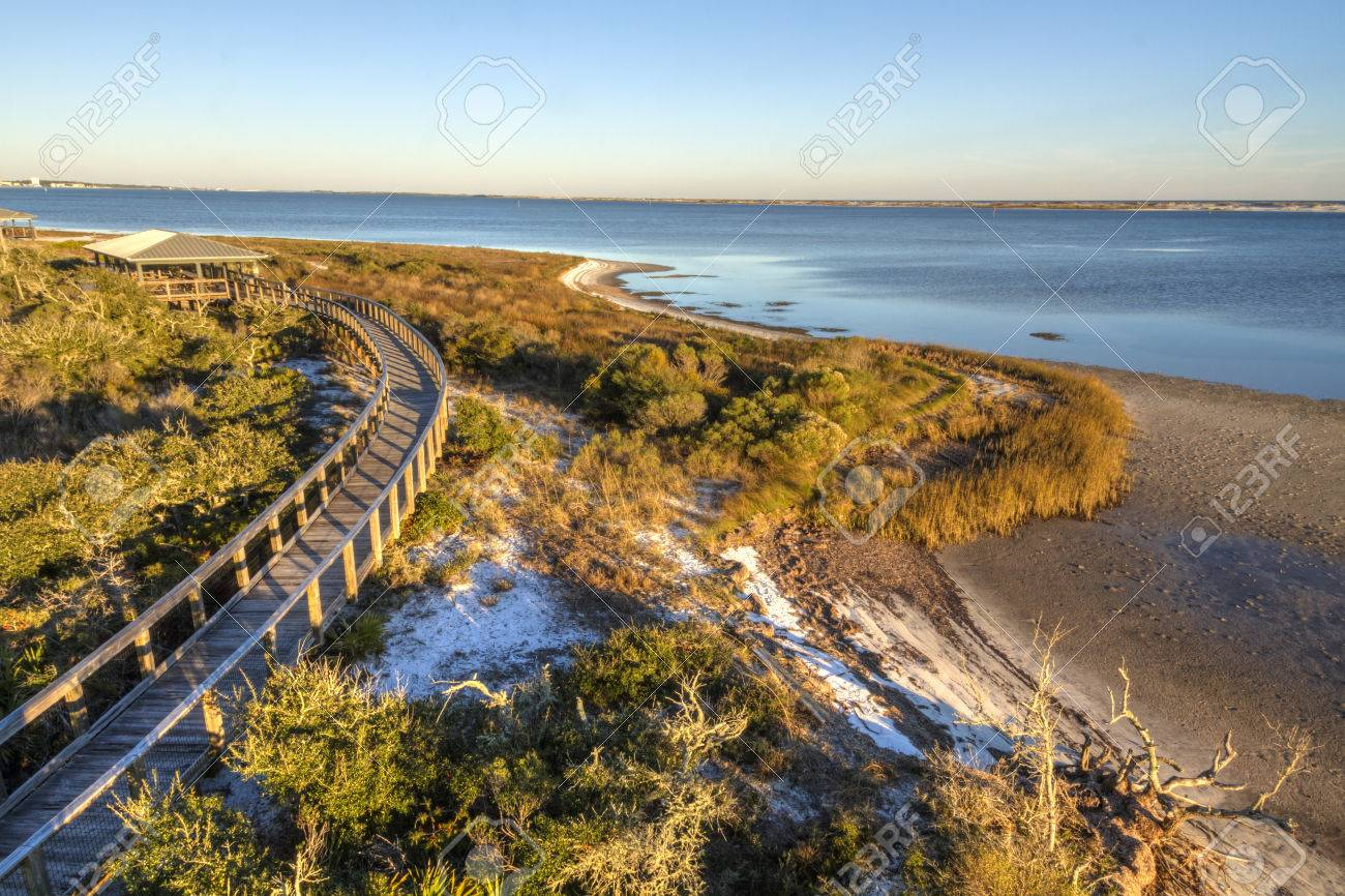 A boardwalkcurves over the vegetation on the dunes in Big Lagoon State Park near Pensacola, Florida - 26752166