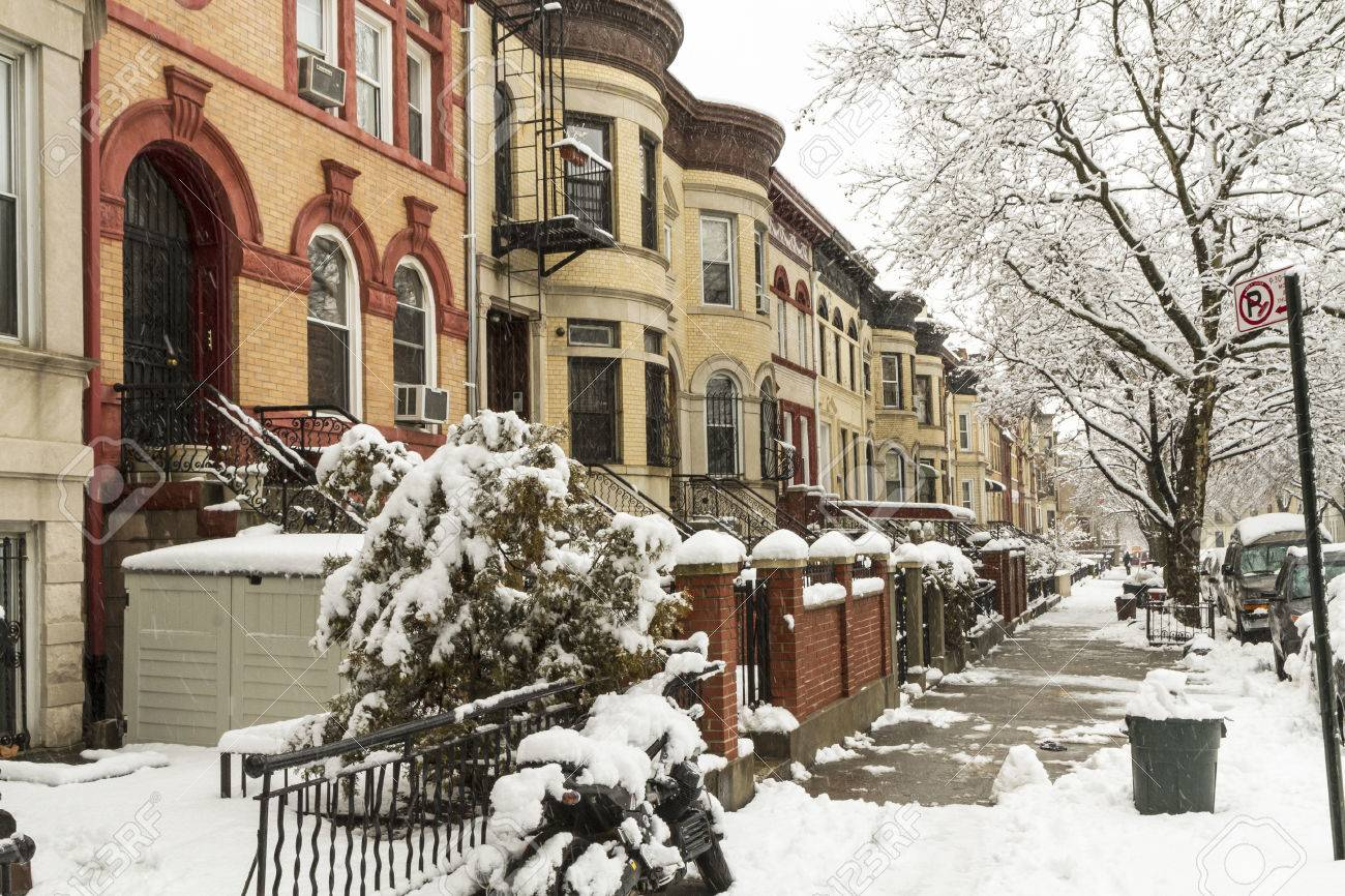 Snow on the stoops of historic Brownstone apartments on New York..